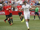 Gareth Bale #11 of Real Madrid celebrates his second half goal against Manchester United during the second half of the Guinness International Champions Cup at Michigan Stadium on August 2, 2014