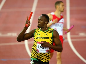 Usain Bolt of Jamaica celebrates winning gold in the Men's 4x100 metres relay final at Hampden Park during day ten of the Glasgow 2014 Commonwealth Games on August 2, 2014