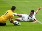 Newcastle's Emmanuel Riviere slides towards the Real Sociedad keeper on August 10, 2014
