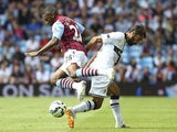Parma's Mattia Cassani and Aston Villa's Charles N'Zogbia on August 9, 2014