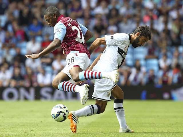 Parma's Mattia Cassani and Aston Villa's Charles N'Zogbia on August 9, 2014