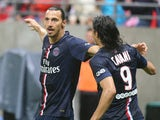 Paris Saint-Germain's Swedish midfielder Zlatan Ibrahimovic celebrates with his teammate Uruguayan forward Edinson Cavani after scoring during the French L1 football match between Stade de Reims and Paris Saint-Germain (PSG), on August 8, 2014