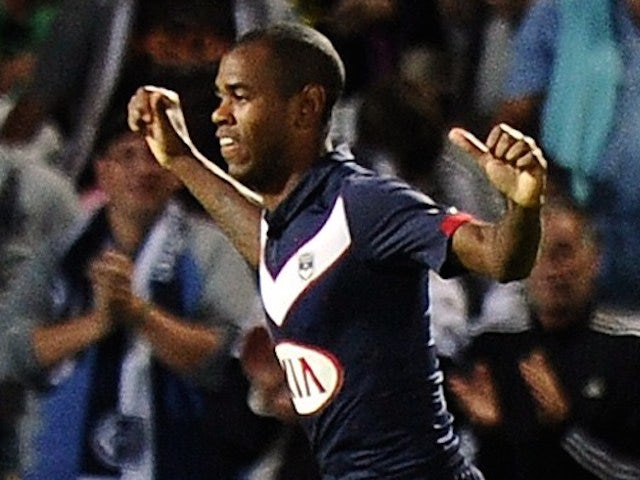 Bordeaux's Uruguayan forward Diego Rolan (C) celebrates with teammates after scoring a goal during the French L1 football match Bordeaux (FCGB) vs Moncao (ASMFC) on August 17, 2014