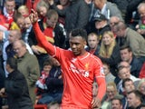 Liverpool's English striker Daniel Sturridge celebrates scoring his team's second goal during the English Premier League football match between Liverpool and Southampton at Anfield stadium in Liverpool, northwest England, on August 17, 2014