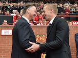 United boss Louis van Gaal and Swansea manager Garry Monk shake hands prior to their clash at Old Trafford on August 16, 2014