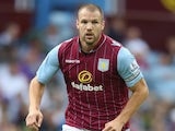 Ron Vlaar of Aston Villa runs with the ball during the pre season friendly match between Aston Villa and Parma at Villa Park on August 9, 2014