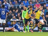 Aaron Ramsey of Arsenal celebrates scoring his team's first goal during the Barclays Premier League match between Everton and Arsenal at Goodison Park on August 23, 2014