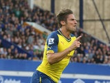 Arsenal's French striker Olivier Giroud celebrates scoring the equalising 2-2 goal during the English Premier League football match between Everton and Arsenall at Goodison Park in Liverpool, northwest England on August 23, 2014