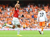 Arsenal's English striker Theo Walcott celebrates after scoring a third goal during the English Premier League football match between Arsenal and Blackpool at the Emirates Stadium in London, England on August 21, 2010