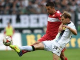 Stuttgart's Bosnian striker Vadad Ibisevic and Monchengladbach's defender Tony Jantschke vie for the ball during the German first division Bundesliga football match Borussia Moenchengladbach v VfB Stuttgart at Borussia Park Stadium in Moenchengladbach, Ge
