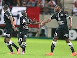 Caen's teammates celebrate after Caen's French midfielder N'golo Kante scored during the French L1 football match Reims (SR) vs Caen (SMC) on August 23, 2014