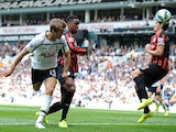 Tottenham Hotspur's English defender Eric Dier (L) scores their second goal past Queens Park Rangers' English midfielder Joey Barton (R) during the English Premier League football match on August 24, 2014