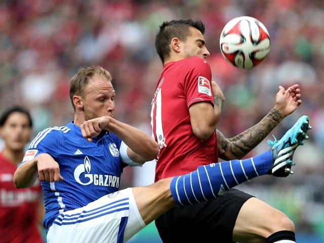 Schalke's defender Benedikt Howedes vies with Hanover's Spanish striker Joselu during the German first division Bundesliga football match Hannover 96 v FC Schalke 04, at HDI-Arena in Hanover, Germany on August 23, 2014