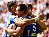 Ryan Hall of Leeds celebrates with team mates after scoring a try during the Tetley's Challenge Cup Final between Leeds Rhinos and Castleford Tigers on August 23, 2014