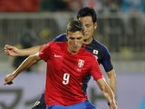Stefan Scepovic of Serbia in action against Maya Yoshida of Japan during an international friendly match between Serbia and Japan at stadium Karadjordje on October 11, 2013
