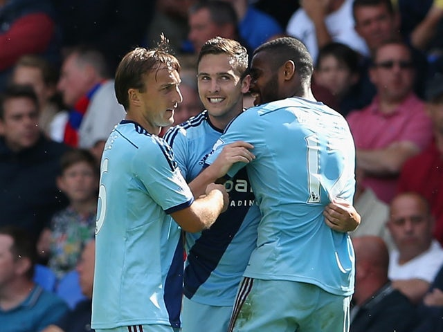 Stewart Downing of West Ham celebrates scoring his team's second goal with team mates during the Barclays Premier League match between Crystal Palace and West Ham United at Selhurst Park on August 23, 2014