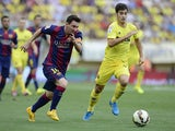 Barcelona's Argentinian forward Lionel Messi vies with Villarreal's midfielder Manuel Trigueros Munoz during the Spanish league football match Villarreal vs Barcelona at the Camp El Madrigal stadium in Villareal on August 31, 2014
