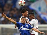 Bayern Munich's Spanish defender Xabi Alonso, Bayern Munich's Austrian midfielder David Alaba and Schalke's forward Sidney Sam vie for the ball during the German first division Bundesliga football match Schalke 04 vs Bayern Munich in Gelsenkirchen, wester