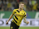 Dortmund's midfielder Marco Reus celebrates scoring the 0-1 goal during the German first division Bundesliga football match FC Augsburg vs Borussia Dortmund in Augsburg, southern Germany, on August 29, 2014
