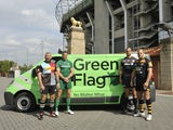 Players from Harlequins, London Irish, Saracens and London Wasps pose in front of a Green Flag van at Twickenham ahead of the 2014-15 Aviva Premiership season