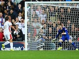Will Grigg of Milton Keynes Dons scores his second goal past goalkeeper David De Gea of Manchester United during the Capital One Cup Second Round match on August 26, 2014