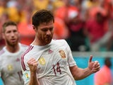 Spain's midfielder Xabi Alonso celebrates scoring a penalty during a Group B football match between Spain and the Netherlands at the Fonte Nova Arena in Salvador during the 2014 FIFA World Cup on June 13, 2014