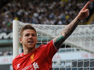 Liverpool's Spanish defender Alberto Moreno celebrates scoring their third goal during the English Premier League football match against Tottenham Hotspur on August 31, 2014