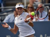 Ekaterina Makarova of Russia returns a shot to Eugenie Bouchard of Canada during their 2014 US Open women's singles match at the USTA Billie Jean King National Tennis Center September 1, 2014