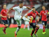 England's Alex Oxlade-Chamberlain controls the ball during the international friendly football match between England and Norway at Wembley Stadium in north London on September 3, 2014