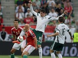 North Ireland's forward Kyle Lafferty and midfielder Oliver Norwood vies for the ball with Hungary's defender Zoltan Liptak and midfielder Jozsef Varga during the UEFA Euro 2016 Group F qualifying match Hungary vs Northern Ireland on September 7, 2014