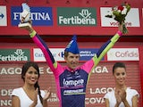 Lampre's Polish cyclist Przemyslaw Niemiec (C) celebrates his victory on the podium of the 15th stage of the 69th edition of 'La Vuelta' Tour of Spain, a 152,2 km ride on September 7, 2014