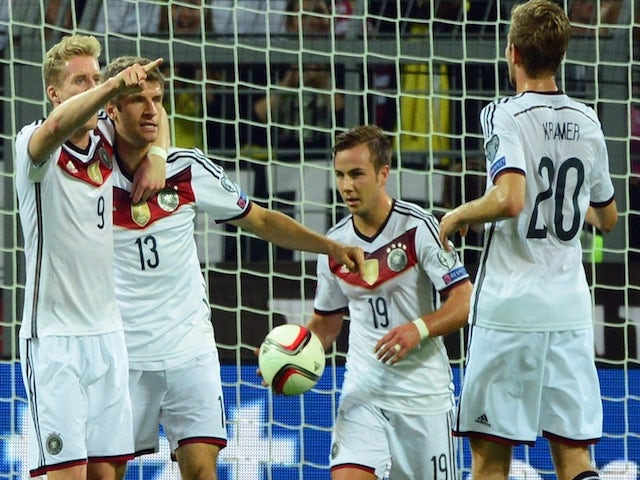 Germany's midfielder Thomas Mueller (2nd L) celebrates with his teammates Andre Schuerrle and Mario Goetze on Septemeber 7, 2014