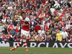 Arsenal's Chilean striker Alexis Sanchez shoots to score during the English Premier League football match between Arsenal and Manchester City at the Emirates Stadium in London on September 13, 2014