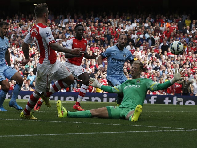 Arsenal's English midfielder Jack Wilshere scores an equalising goal past Manchester City's English goalkeeper Joe Hart bringing the score to 1-1 during the English Premier League football match between Arsenal and Manchester City at the Emirates Stadium