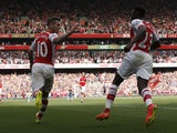 Arsenal's English midfielder Jack Wilshere celebrates scoring an equalising goal bringing the score to 1-1 with teammate English striker Danny Welbeck during the English Premier League football match between Arsenal and Manchester City at the Emirates Sta