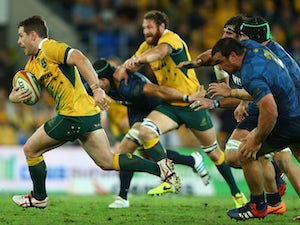Bernard Foley of the Wallabies runs the ball during The Rugby Championship match between the Australian Wallabies and Argentina at Cbus Super Stadium on September 13, 2014