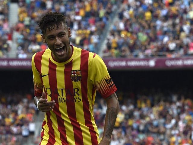 Barcelona's Brazilian forward Neymar da Silva Santos Junior celebrates after scoring during the Spanish league football match FC Barcelona vs Athletic Club Bilbao at the Camp Nou stadium in Barcelona on September 13, 2014