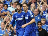 Chelsea's Brazilian-born Spanish striker Diego Costa (R) celebrates scoring with teammate Serbian midfielder Nemanja Matic during the English Premier League football match against Swansea on September 13, 2014