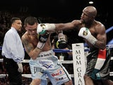 Floyd Mayweather Jr of US slams a right to the face of Marcos Maidana from Argentina on May 3, 2014