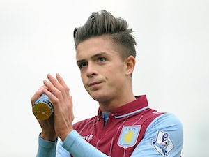 Jack Grealish of Aston Villa applauds the supporters following the Barclays Premier League match between Stoke City and Aston Villa on August 16, 2014