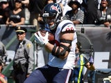 J.J. Watt #99 of the Houston Texans catches a one yard touchdown pass against the Oakland Raiders during the first quarter at O.co Coliseum on September 14, 2014