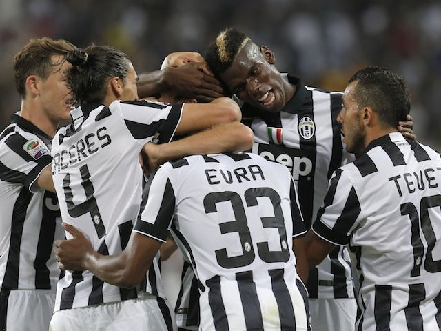 Juventus' players celebrate after scoring during the Italian Serie A football match between Juventus and Udinese on September 13, 2014