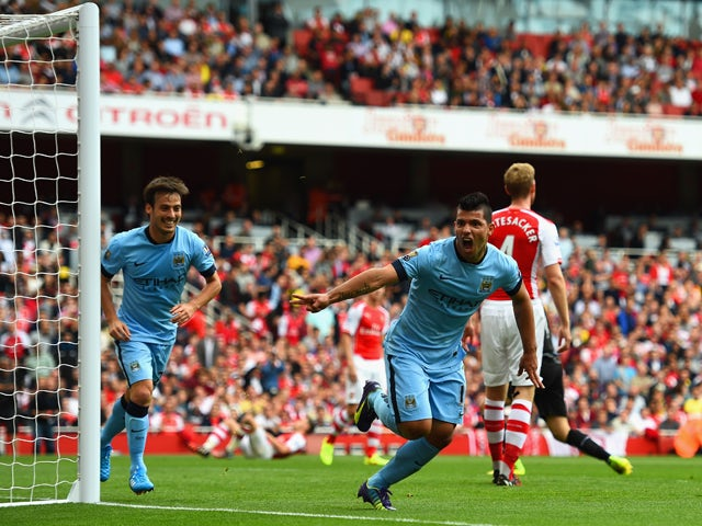 Sergio Aguero of Manchester City celebrates scoring the opening goal during the Barclays Premier League match between Arsenal and Manchester City at Emirates Stadium on September 13, 2014