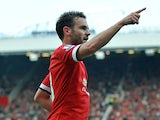 Manchester United's Spanish midfielder Juan Mata celebrates scoring their fourth goal during the English Premier League football match between Manchester United and Queens Park Rangers at Old Trafford in Manchester, north west England on September 14, 201