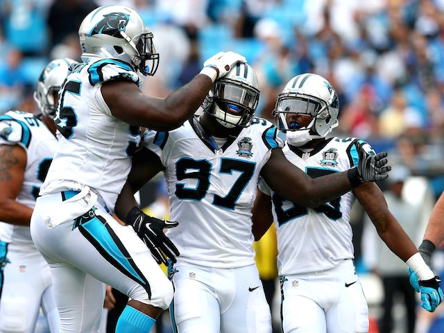 Mario Addison #97 of the Carolina Panthers celebrates with teammates after a sack against the Detroit Lions on September 14, 2014
