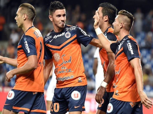 Montpellier's players react after scoring a goal during the French L1 football match between Montpellier and Lorient at the Mosson stadium in Montpellier, southern France, on September 13, 2014
