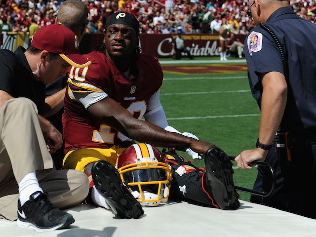 Quarterback Robert Griffin III #10 of the Washington Redskins is carted off the field after being injured during a game against the Jacksonville Jaguars on September 14, 2014