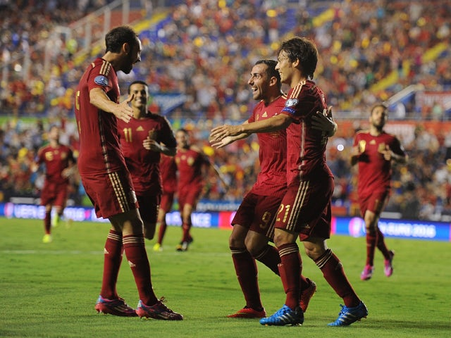 Paco Alcacer celebrates with David Silva after scoring Spain's 2nd goal during the UEFA EURO 2016 Group C Qualifier between Spain and FYR of Macedonia at Estadio Ciutat de Valencia on September 8, 2014