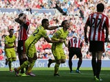 Tottenham Hotspur's Danish midfielder Christian Eriksen celebrates scoring their second goal during the English Premier League football match between Sunderland and Tottenham Hotspur at the Stadium of Light in Sunderland on September 13, 2014
