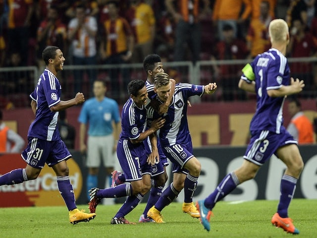 Anderlecht players celebrate their goal by midfielder Dennis Praet against Galatasaray during their UEFA Champions Leauge group D match on September 16, 2014